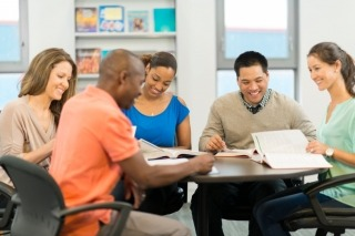 Diverse group of adults studying and working together
